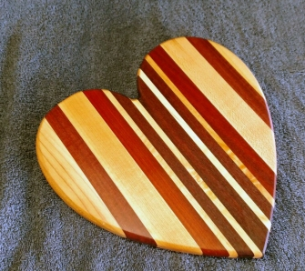 "Heart 18 - 902. Hard Maple, Bubinga, Purpleheart & Bloodwood. Jatoba, 11"" x 11"" x 3/4""."
