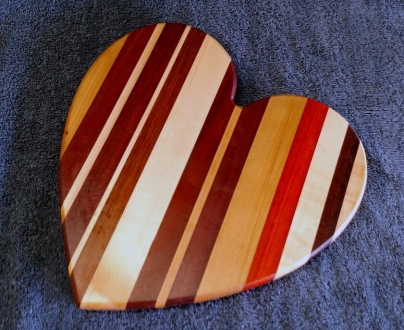 "Heart 18 - 901. Cherry, Purpleheart, Hard Maple, Jatoba & Padauk. 11"" x 11"" x 3/4""."