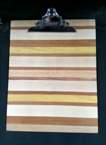 "Clipboard 18 - 802. Letter Size. Hard Maple, Cherry, Yellowheart & Honey Locust. 1"" clip."