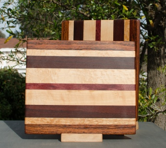 "Cheese Board 18 - 104. Jatoba, Birds Eye Maple, Black Walnut & Bloodwood. 9"" x 11"" x 5/8""."
