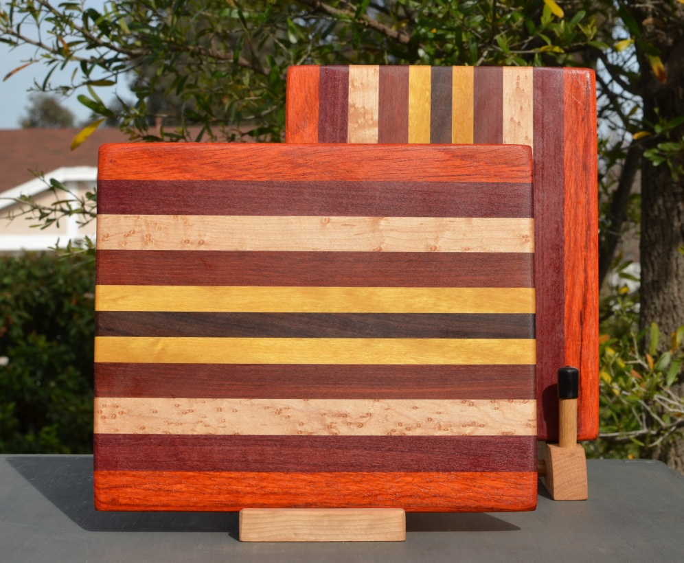 "Cheese Board 18 - 108. Padauk, Bloodwood, Hard Maple, Bubinga, Yellowheart & Jarrah. 8"" x 11"" x 5/8""."