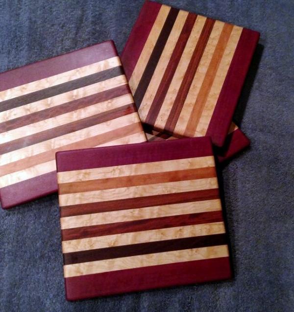 "Cheese Board 18 - 118. Purpleheart, Hard Maple, Cherry, Bubinga, Bloodwood & Jarrah. 9"" x 11"" x 5/8""."