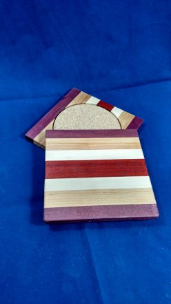 Coasters 18 - 18. Purpleheart, Cherry, Hard Maple & Padauk.