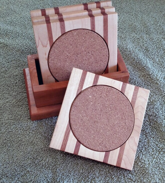 Coasters 18 - 29. Hard Maple & Sapele coasters, shown with a Jatoba holder.