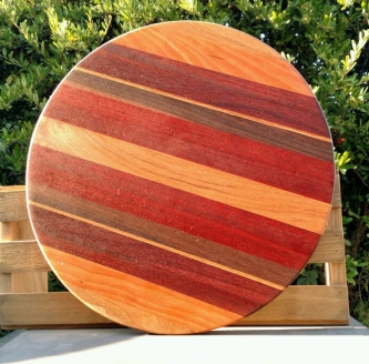 "Lazy Susan 18 - 16. Woods include Padauk, Cherry & Black Walnut. 18"" diameter."