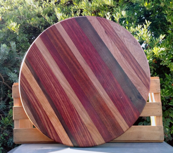 "Lazy Susan 18 - 17. Woods include Cherry, Padauk & Black Walnut. 18"" diameter."