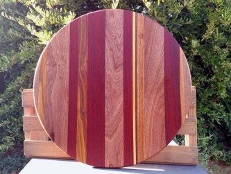 "Lazy Susan 18 - 18. Woods include Sapele, Purpleheart, Canarywood, Yellowheart & Black Walnut. 18"" diameter."