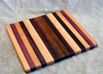 """Cheese Board 18 - 125. Hard Maple, Purpleheart, Cherry, Jatoba & Bloodwood. 10"""" x 11"""" x 3/4""""."""