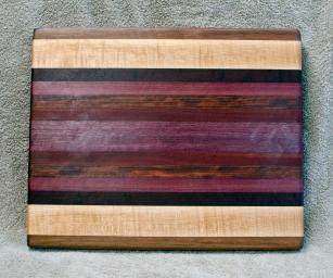 "Cutting Board 18 - 324. Black Walnut, Hard Maple, Jarrah, Purpleheart, Bubinga & Bloodwood. 12"" x 16"" x 1-1/4"". Edge Grain."