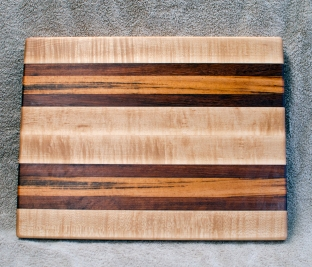 "Cutting Board 18 - 325. 12"" x 16"" x 1-1/4"". Hard Maple, Jatoba & Goncalo Alves. Edge Grain."