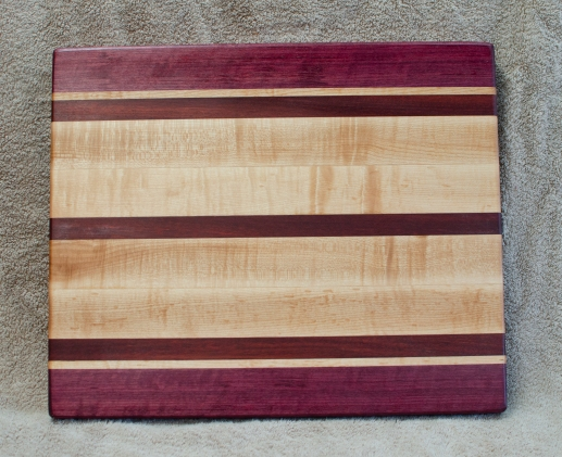 "Cutting Board 18 - 327. Purpleheart, Bloodwood & Hard Maple. 12"" x 16"" x 1-1/4"". Edge Grain."